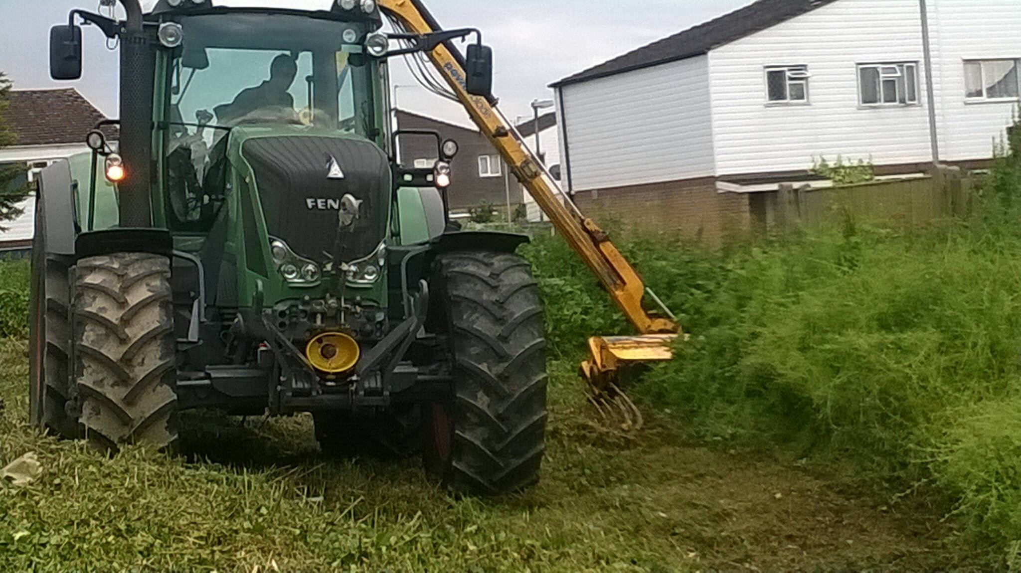 Tractor fitted with hedgecutter on vegetation management task