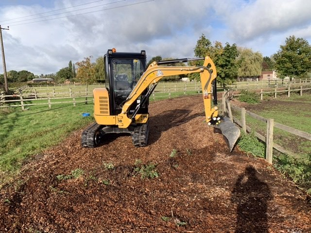 Mini digger repairing riding track