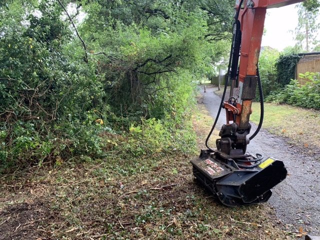 Excavator and flail on site and vegetation clearance project